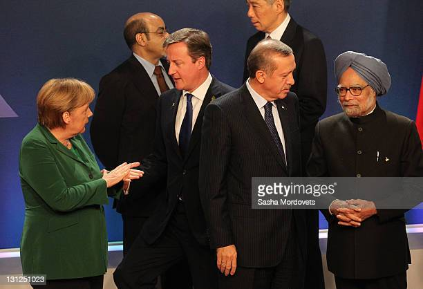 German Changellor Angela Merkel talks to Britain's Prime Minister David Cameron as Turkish Prime Minister Tayyip Erdogan talks to Indian Prime...