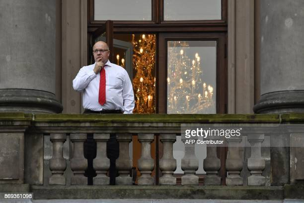 German Chief of Staff Peter Altmaier gestures on the balcony during a break of exploratory talks to form a new government on November 2 2017 in...