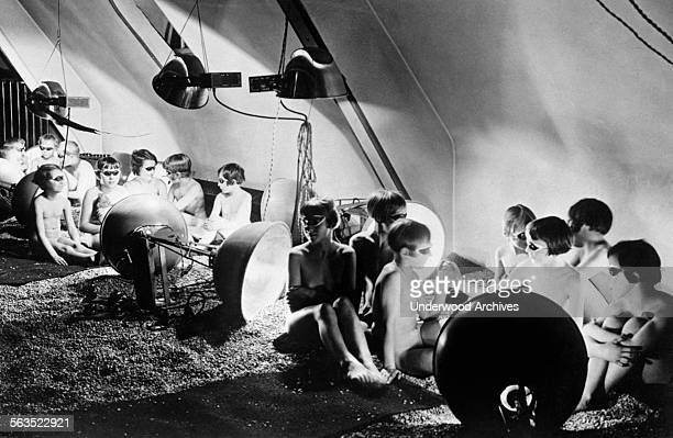 German children are given doses of artificial sunshine to improve their health Berlin Germany circa 1929 Here they are sitting nude on an artificial...