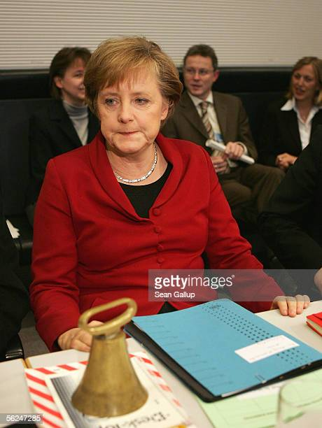 German Christian Democrat and future German Chancellor Angela Merkel attends a meeting of the CDU Bundestag faction where party member Volker Kauder...