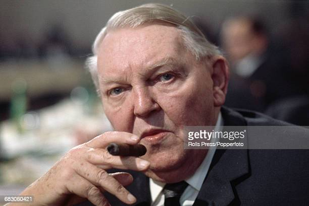 German Christian Democrat politician and former Chancellor of Germany Ludwig Erhard pictured smoking a cigar at an event in Germany in 1970
