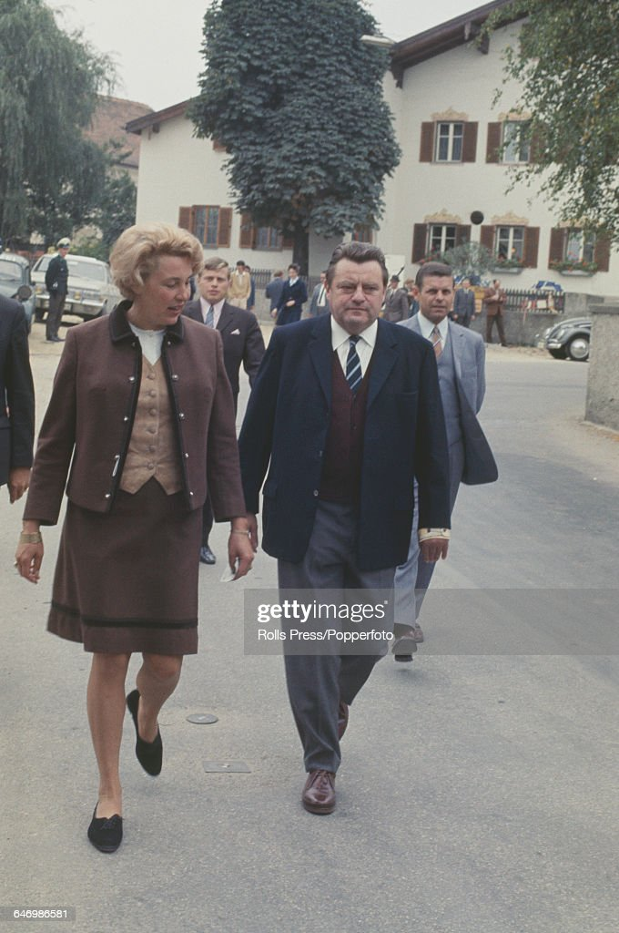 German Christian Social Union politician and Federal Minister of Finance Franz Josef Strauss walks with his wife Marianne to vote in the 1969 West...