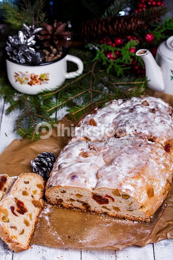 german christmas cake stollen with dry fruits and nuts stock photo