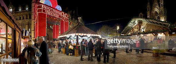 German Christmas market in front of Town Hall, Albert Square, Manchester UK