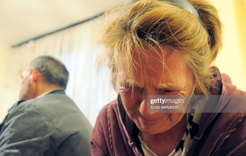 German citizen Christine Siegner is pictured in the house of Milenko and Slavojka Marinkovic in the northwestern Tuzla region village of Karavlasi on May 27, 2012. Bettina, her 19-year-old daughter has been rescued on May 17 by Bosnian police after allegedly being held captive by Milenko and Slavojka Marinkovic for eight years during which she was forced to eat pig feed and pull a horse-cart. The Marinkovics were arrested in this home on May 17 after police received the tip-off from a neighbour earlier this month. Local media reported that the girl had arrived in Bosnia from Germany eight years ago with her mother, who could have entered into a sham marriage with Milenko Marinkovic to allow him to obtain a German residency permit.