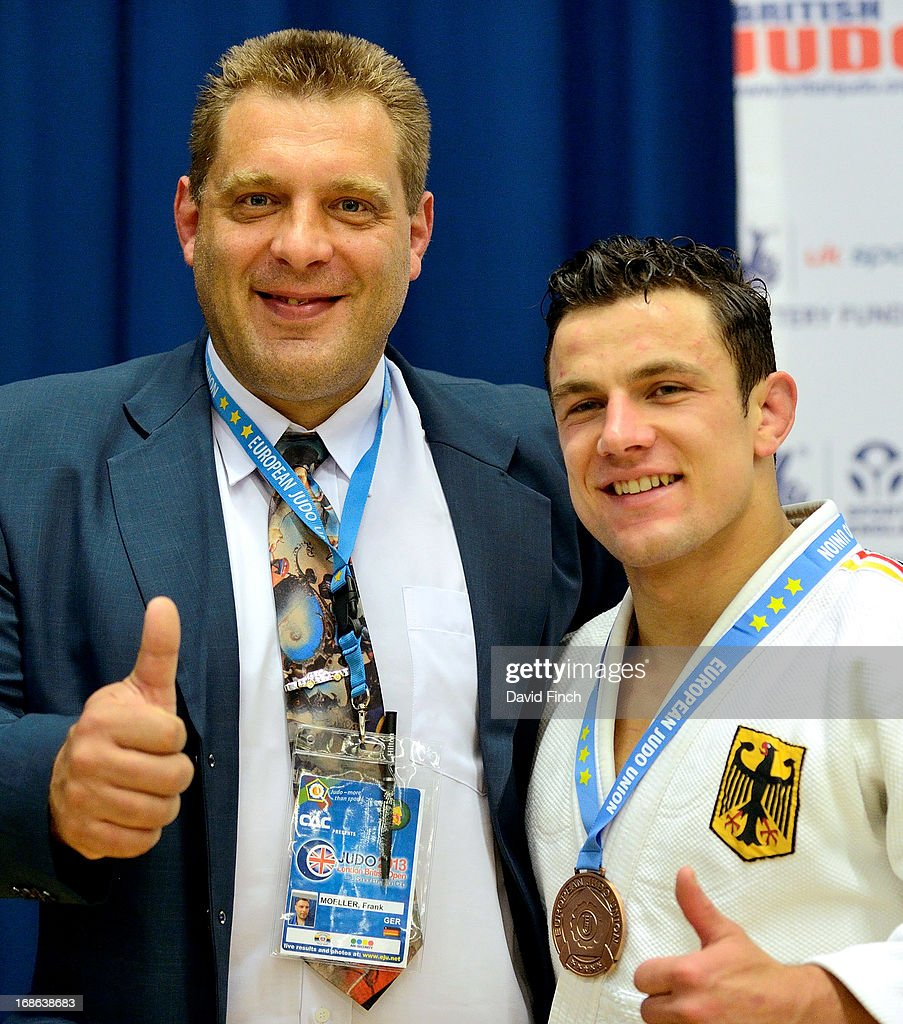 German coach Frank Moeller, whose competitive career included a World silver medal and European gold, stands with German u81kgs bronze medallist, Sven Maresch, after the medal ceremony during day 2 of the London British Open Judo Championships at the K2 on May 12, 2013 in Crawley, United Kingdom.
