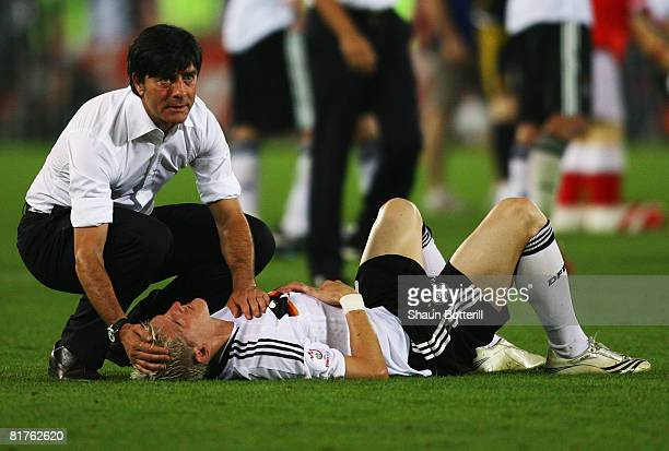 German coach Joachim Loew comforts Bastian Schweinsteiger after the UEFA EURO 2008 Final match between Germany and Spain at Ernst Happel Stadion on...