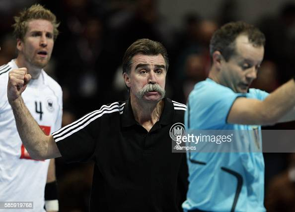 German coach / trainer Heiner Brand pumping a fist towards referee N Krstic after the IHF World Championships match Norway vs Germany in Croatia