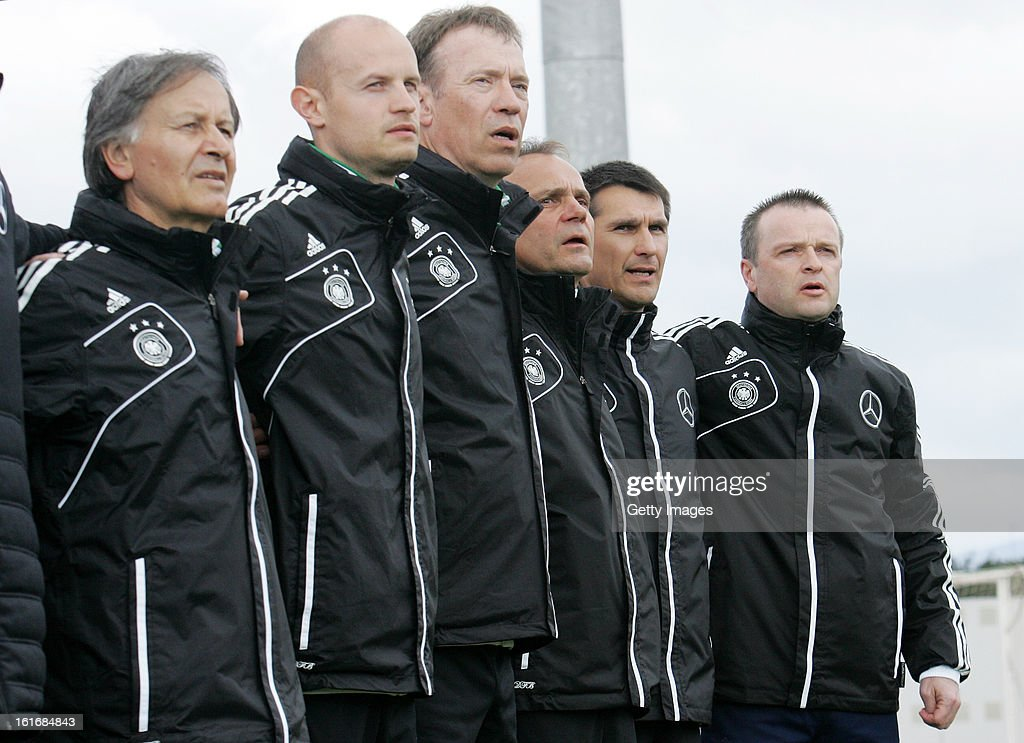 German coaching staff line up for the national anthem during the Under17 Algarve Youth Cup match between U17 Portugal and U17 Germany at the Stadium Bela Vista on February 12, 2013 in Parchal, Portugal.