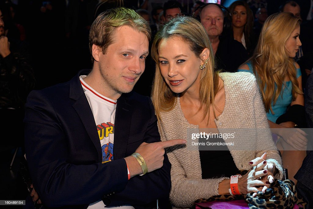 German comedia Oliver Pocher and his wife Alessandra attend the IBF Middleweight Eliminator fight between Felix Sturm of Germany and Sam Soliman of Australia at ISS Dome on February 1, 2013 in Duesseldorf, Germany.