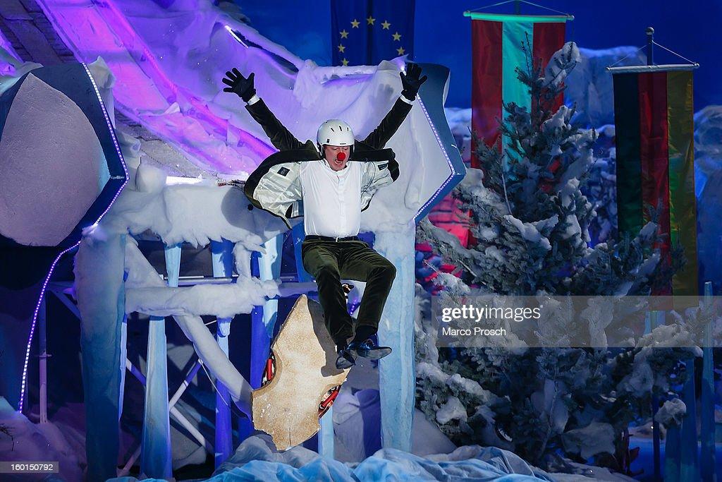 German comedian Dr. Eckart von Hirschhausen jumps off a ski jump during the 'Winterfest der fliegenden Stars' TV-Show on January 26, 2013 at the Freiheitshalle in in Hof, Germany.