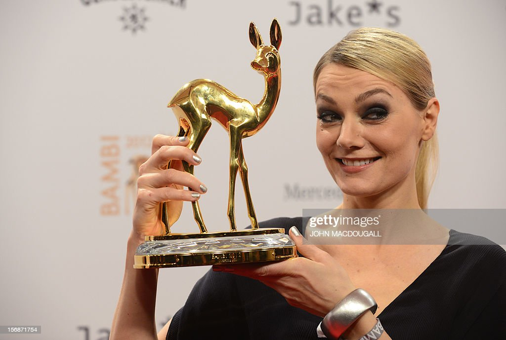 German comedian Martina Hill poses with her trophy during the Bambi awardings in Duesseldorf, western Germany, on November 22, 2012. The Bambis are the main German media awards. AFP PHOTO / JOHN MACDOUGALL