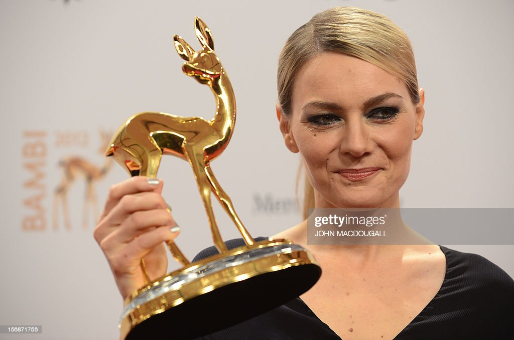 German comedian Martina Hill poses with her trophy during the Bambi awardings in Duesseldorf, western Germany, on November 22, 2012. The Bambis are the main German media awards.