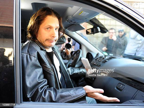 German comedian Oliver Pocher dressed up as Joerg Kachelmann is pictured in a car outside the district court on day one of the trial against the tv...