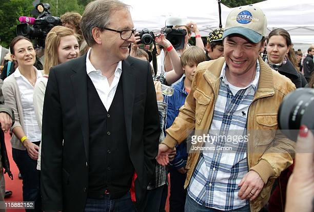 German comedian Olli Dittrich and Michael 'Bully' Herbig attend the bullyversum opening at Bavaria film City on June 11 2011 in Munich Germany