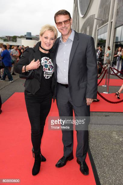German comedian Tanja Schumann and her husband Stefan Burmeister attend the 'Billy Elliott The Musical' Hamburg Premiere at Mehr Theater on June 29...
