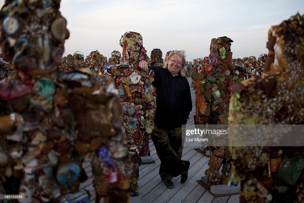 German conceptual artist <a gi-track='captionPersonalityLinkClicked' href=/galleries/search?phrase=HA+Schult&family=editorial&specificpeople=234643 ng-click='$event.stopPropagation()'>HA Schult</a> stands amongst his sculptures which feature in his 'Trash People' exhibition in the Ariel Sharon Park, on April 6, 2014 outside Tel Aviv, Israel. The 'Trash People' exhib features life-size figures made from 20 tons of recycled iron, glass, computer parts, cans and industrial waste. The exhibition has been traveling for 18 years around the world, with stops in Paris La Defense, Moscow Red Square, the Great Wall of China, Egypt's Pyramids in Giza, Piazza del Popolo in Rome, Antarctica and now Israel, where it will be on display until April 26, 2014.