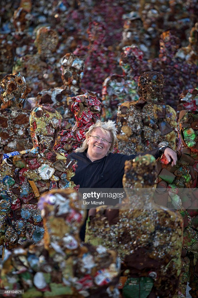 German conceptual artist <a gi-track='captionPersonalityLinkClicked' href=/galleries/search?phrase=HA+Schult&family=editorial&specificpeople=234643 ng-click='$event.stopPropagation()'>HA Schult</a> stands amongst his sculptures which feature in his 'Trash People' exhibition in the Ariel Sharon Park, a former waste site, on April 6, 2014 outside Tel Aviv, Israel. The 'Trash People' exhib features life-size figures made from 20 tons of recycled iron, glass, computer parts, cans and industrial waste. The exhibition has been traveling for 18 years around the world, with stops in Paris La Defense, Moscow Red Square, the Great Wall of China, Egypt's Pyramids in Giza, Piazza del Popolo in Rome, Antarctica and now Israel, where it will be on display until April 26, 2014.