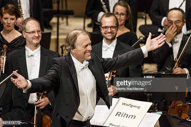 German conductor Thomas Hengelbrock takes applause after the opening concert of the Elbphilharmonie concert hall on January 11 2017 in Hamburg...