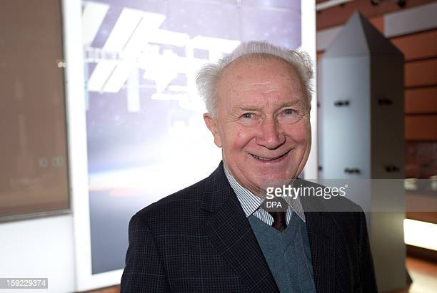 German cosmonaut Sigmund Jaehn poses on January 10 2013 at the orbitall space center of the FEZ youth education and leisure park in Berlin on the...