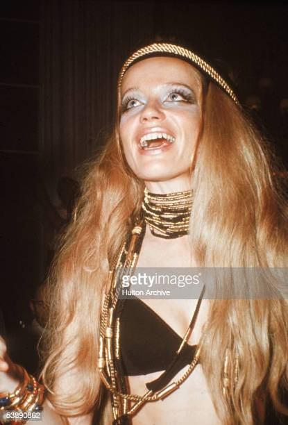 German countess and fashion model Veruschka looks up and smiles as she dances at a party during Carnaval Rio de Janeiro Brazil February 14 1969 She...