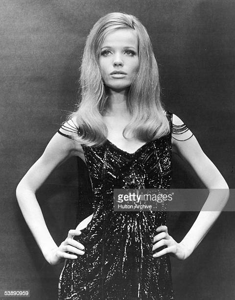 German countess and fashion model Veruschka perfects the disaffected supermodel look with her hands on her hips and her lips pursed circa 1968