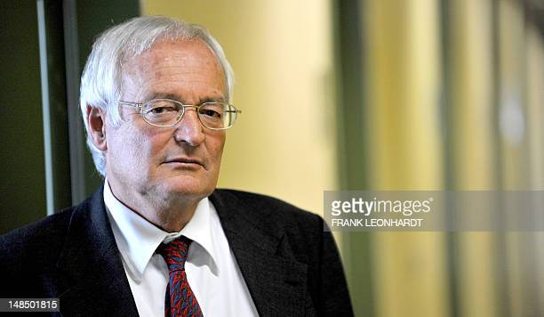 German criminal judge Joachim Eckert poses at his office at the higher regional court in Munich southern Germany on July 18 2012 Eckert will head the...