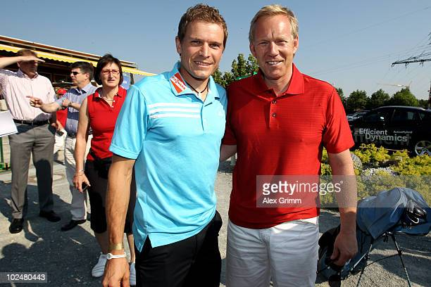 German cross country skier Tobias Angerer poses with tv presenter Johannes B Kerner during the TaylorMadeadidas Golf ProAm tournament on June 28 2010...