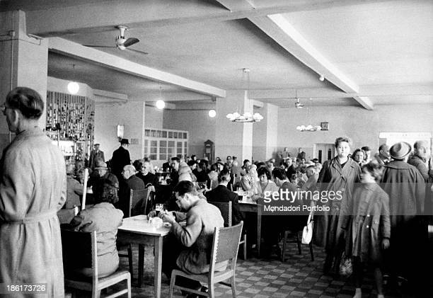 German customers eating in a selfservice restaurant East Berlin August 1961
