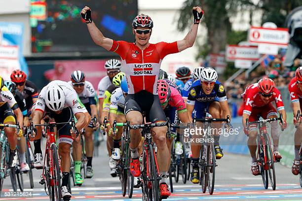 German cyclist Andre Greipel raises his arms in victory as he crosses the finish line of the Giro d'Italia 7th stage in Foligno on May 13 2016 / AFP...