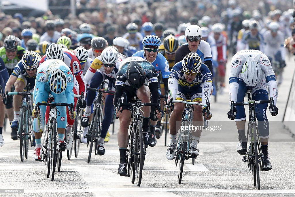 German cyclist Marcel Kittel (R) of team Argos-Shimano crosses the finish line to win ahead of British Mark Cavendish (C) of team Omega Pharma - Quick Step and Dutch Barry Markus (2nd R) of team Vacansoleil-DCM the 101st edition of the 'Scheldeprijs' one day cycling race, a 204,2 km track, on April 3, 2013. Belgium Out