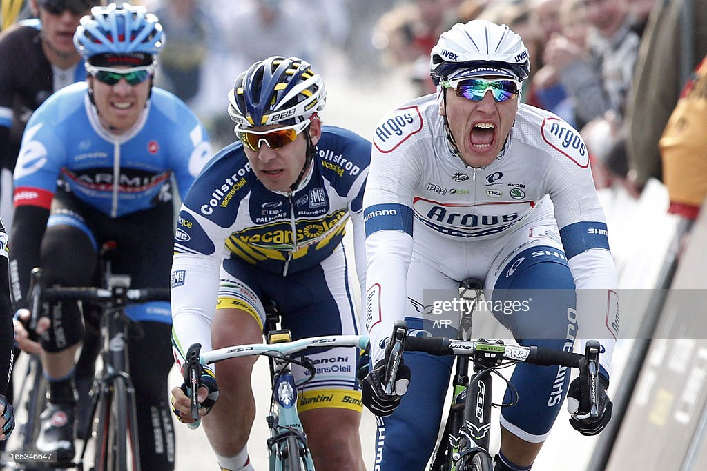 German cyclist Marcel Kittel (R) of team Argos-Shimano crosses the finish line to win the 101st edition of the 'Scheldeprijs' one day cycling race, a 204,2 km track, on April 3, 2013. Belgium Out