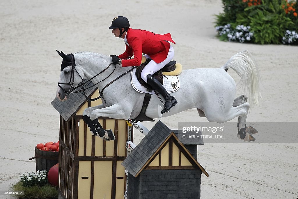 German Daniel Deusser rides Cornet d'Amour on September 3 2014 during the Individual Jumping competition of the 2014 FEI World Equestrian Games in...