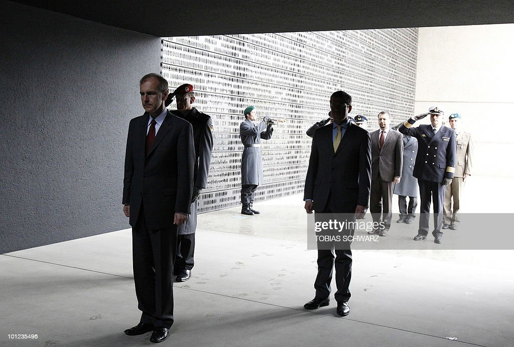 German Defence Minister Karl-Theodor zu Guttenberg (C) and his Polish counterpart Bogdan Klich (L) attend a wreath laying ceremony at the Bundeswehr memorial in the courtyard of the Defence Ministry in Berlin on May 28, 2010 prior to bilateral talks.