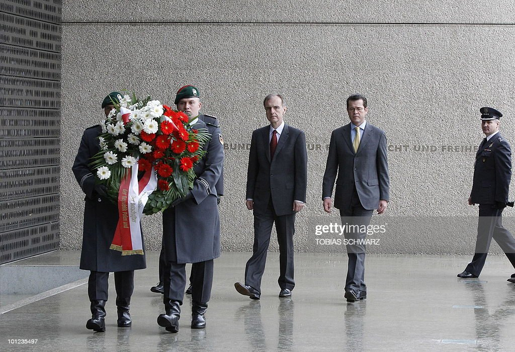 German Defence Minister Karl-Theodor zu Guttenberg (2nd R) and his Polish counterpart Bogdan Klich (3rd R) attend a wreath laying ceremony at the Bundeswehr memorial in the courtyard of the Defence Ministry in Berlin on May 28, 2010 prior to bilateral talks.