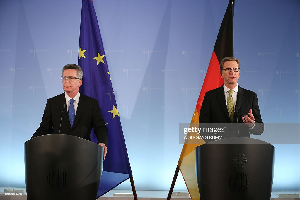 German Defence Minister Thomas de Maiziere and Foreign Minister Guido Westerwelle (R) addresses a press conference at the foreign ministry in Berlin on November 14, 2012. Germany revealed details of its likely drawdown plan for Afghanistan with the aim of seeing its number of troops fall to 3,300 by February 2014, the two ministers said.