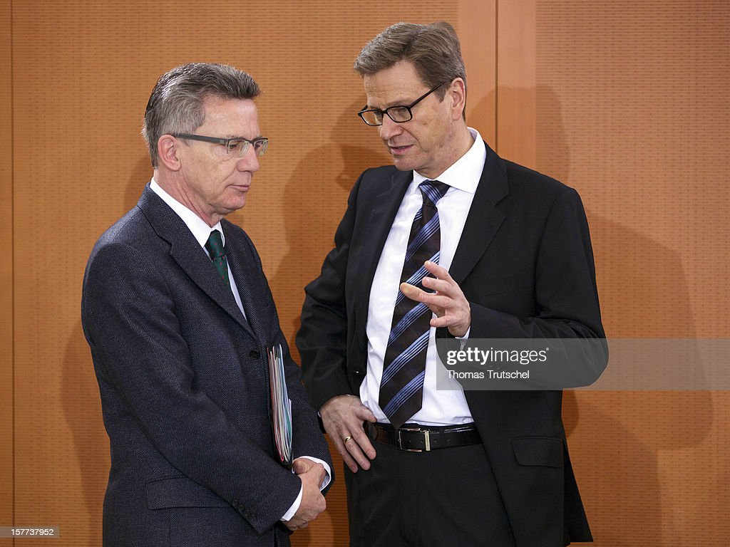German Defence Minister <a gi-track='captionPersonalityLinkClicked' href=/galleries/search?phrase=Thomas+de+Maiziere&family=editorial&specificpeople=618845 ng-click='$event.stopPropagation()'>Thomas de Maiziere</a> (L) and German Foreign Minister <a gi-track='captionPersonalityLinkClicked' href=/galleries/search?phrase=Guido+Westerwelle&family=editorial&specificpeople=208748 ng-click='$event.stopPropagation()'>Guido Westerwelle</a> talk prior the weekly German government cabinet meeting on December 6, 2012 in Berlin, Germany.