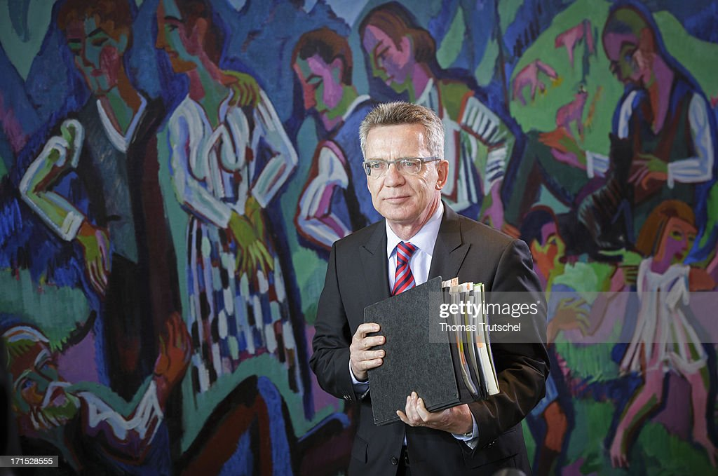 German Defence Minister <a gi-track='captionPersonalityLinkClicked' href=/galleries/search?phrase=Thomas+de+Maiziere&family=editorial&specificpeople=618845 ng-click='$event.stopPropagation()'>Thomas de Maiziere</a> attends Weekly German Government Cabinet Meeting on June 26 2013 in Berlin, Germany.