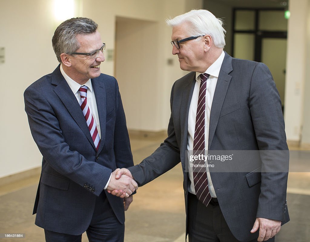 German Defence Minister <a gi-track='captionPersonalityLinkClicked' href=/galleries/search?phrase=Thomas+de+Maiziere&family=editorial&specificpeople=618845 ng-click='$event.stopPropagation()'>Thomas de Maiziere</a> (L), from the German Christian Democratic Union (CDU) and <a gi-track='captionPersonalityLinkClicked' href=/galleries/search?phrase=Frank-Walter+Steinmeier&family=editorial&specificpeople=603500 ng-click='$event.stopPropagation()'>Frank-Walter Steinmeier</a> (), head of the Bundestag faction of the German Social Democrats (SPD), shake hands before a Coalition Negotiation meeting at the Defence Ministry on October 31, 2013 in Berlin, Germany. The SPD, CDU and Bavarian Chrisitan Democrats (CSU) are seeking to create a coaltion government following German elections in September.