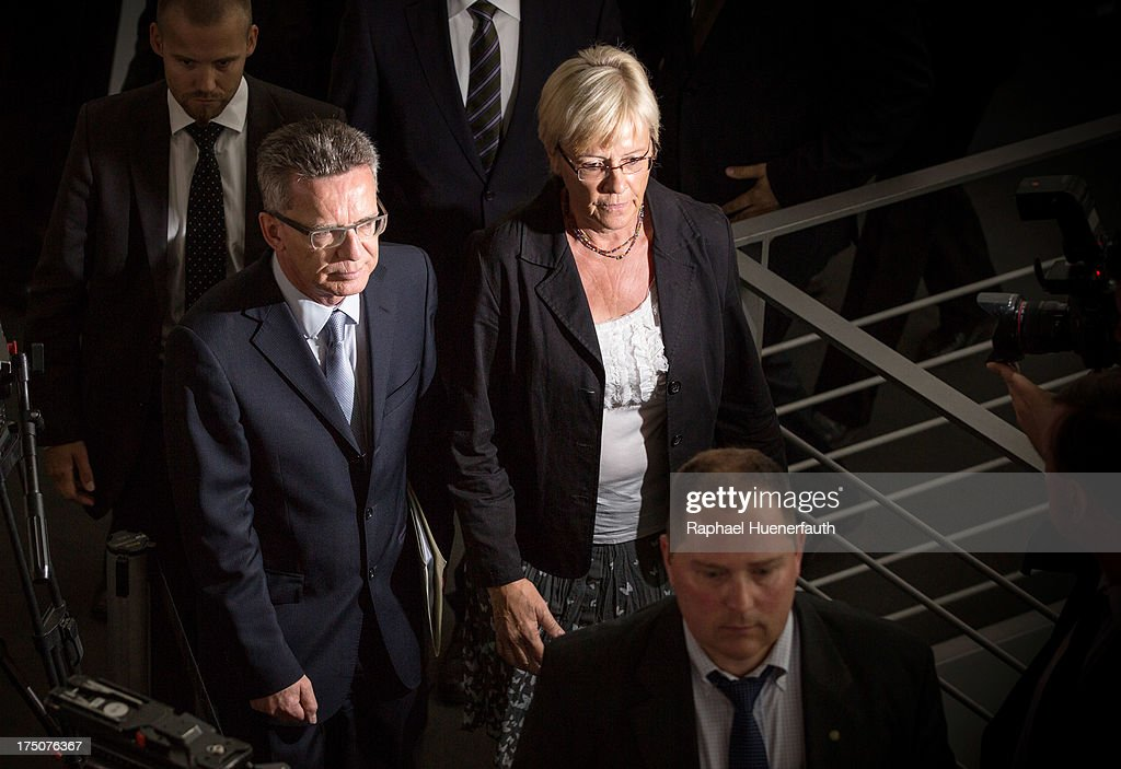 German Defence Minister <a gi-track='captionPersonalityLinkClicked' href=/galleries/search?phrase=Thomas+de+Maiziere&family=editorial&specificpeople=618845 ng-click='$event.stopPropagation()'>Thomas de Maiziere</a> (L) joins committee chairperson Susanne Kastner to answer questions from parliamentarians at the Bundestag defence commission on June 31, 2013 in Berlin, Germany. De Maiziere is under increasing pressure following the 'EuroHawk' drone debacle, in which de Maiziere announced recently that the German government would cancel the military project, which has already consumed EUR 562 million, due to the complications with domestic flight certification. The 'EuroHawk' is a modified version of the Northrop Grumman RQ-4 Global Hawk.
