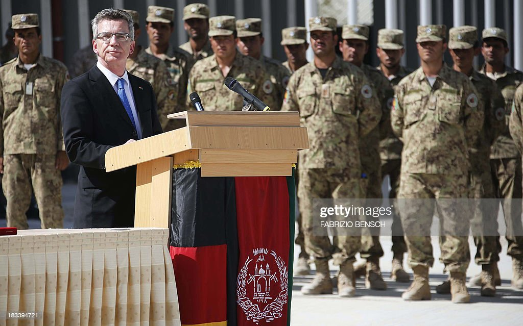 German Defence Minister Thomas de Maiziere speaks during the handover ceremony of a German base to Afghan armed forces in Kunduz, Afghanistan on October 6, 2013. Soldiers of the German contingency of the International Security Assistance Force (ISAF) withdrew from their base in Kunduz and the camp will be used by the Afghan National Army (ANA) and the Afghan National Civil Order Police (ANCOP).