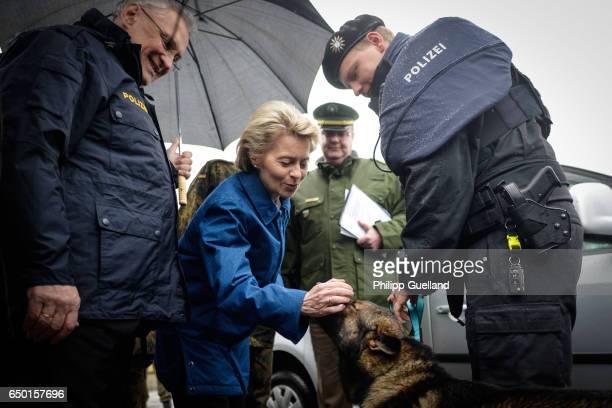 German Defence Minister Ursula von der Leyen and Bavarian Interior Minister Joachim Hermann pet police explosives detection dog 'Frankie' after a...