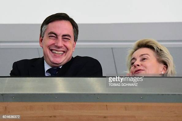 German Defence Minister Ursula von der Leyen and David McAllister leader of the CDU in Lower Saxony look down as journalists wait for the press...