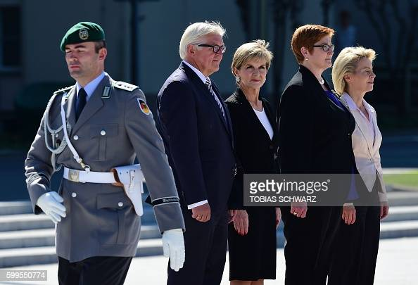 German Defence Minister Ursula von der Leyen and German Foreign Minister FrankWalter Steinmeier inspect a military honor guard with Australian...