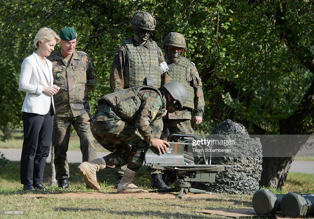 German Defence Minister Ursula von der Leyen and German General Gert-Johannes Hagemann look on as Peshmerga fighters train using milan weapons on October 02, 2014 in Hammelburg, Germany. A total of 32 peshmerga soldiers are at the base to train for one week in the use of the weapon before they return to northern Iraq. Germany has delivered to the peshmerga EUR 70 million worth of weaponry, including the Milan system, assault rifles, machine guns, pistols and other military hardware.