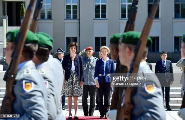 German Defence Minister Ursula von der Leyen and her new French counterpart Sylvie Goulard inspect a military honor guard at the Defence Ministry in...