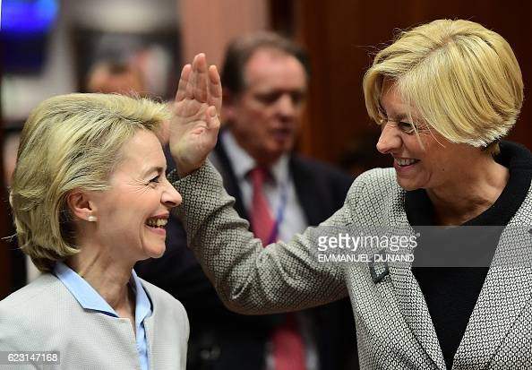 TOPSHOT German Defence Minister Ursula von der Leyen and Italian Defence Minister Roberta Pinotti share a laugh ahead of an EU foreign affairs and...