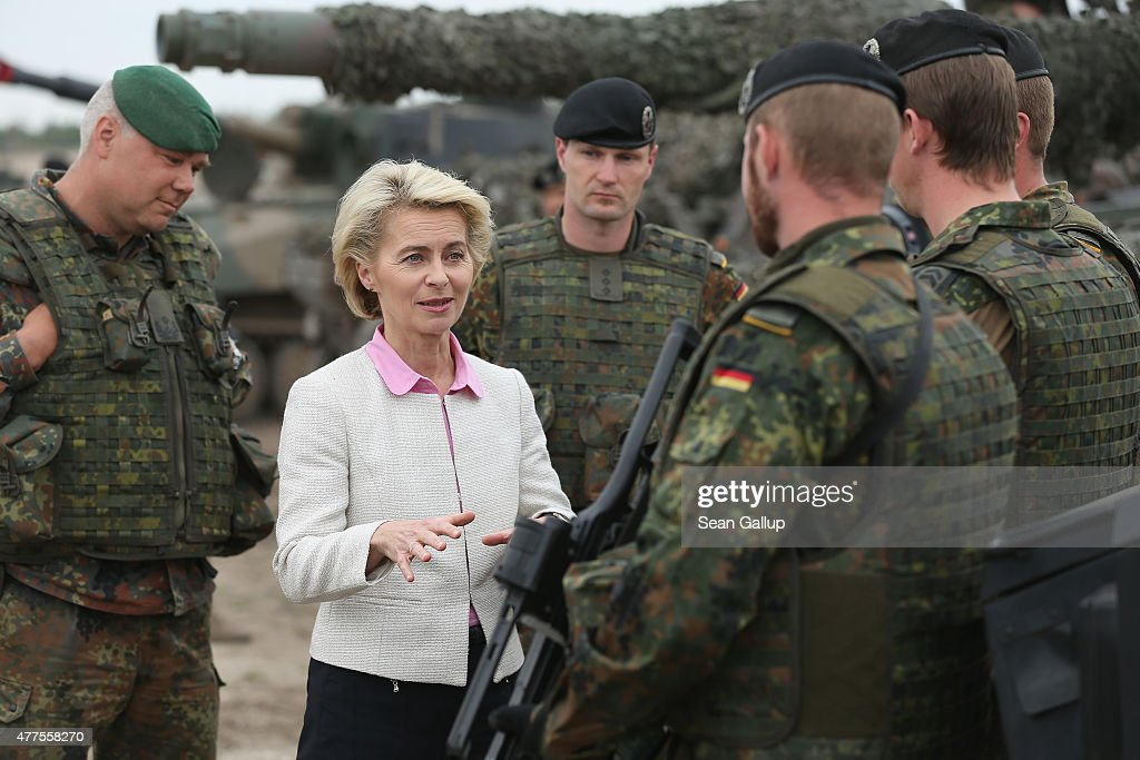 German Defence Minister <a gi-track='captionPersonalityLinkClicked' href=/galleries/search?phrase=Ursula+von+der+Leyen&family=editorial&specificpeople=4249207 ng-click='$event.stopPropagation()'>Ursula von der Leyen</a> chats with troops of the German armed forces, the Bundeswehr, while attending the NATO Noble Jump military exercises of the VJTF forces on June 18, 2015 in Zagan, Poland. The VJTF, the Very High Readiness Joint Task Force, is NATO's response to Russia's annexation of Crimea and the conflict in eastern Ukraine. Troops from Germany, Norway, Belgium, Poland, Czech Republic, Lithuania and Belgium were among those taking part today.