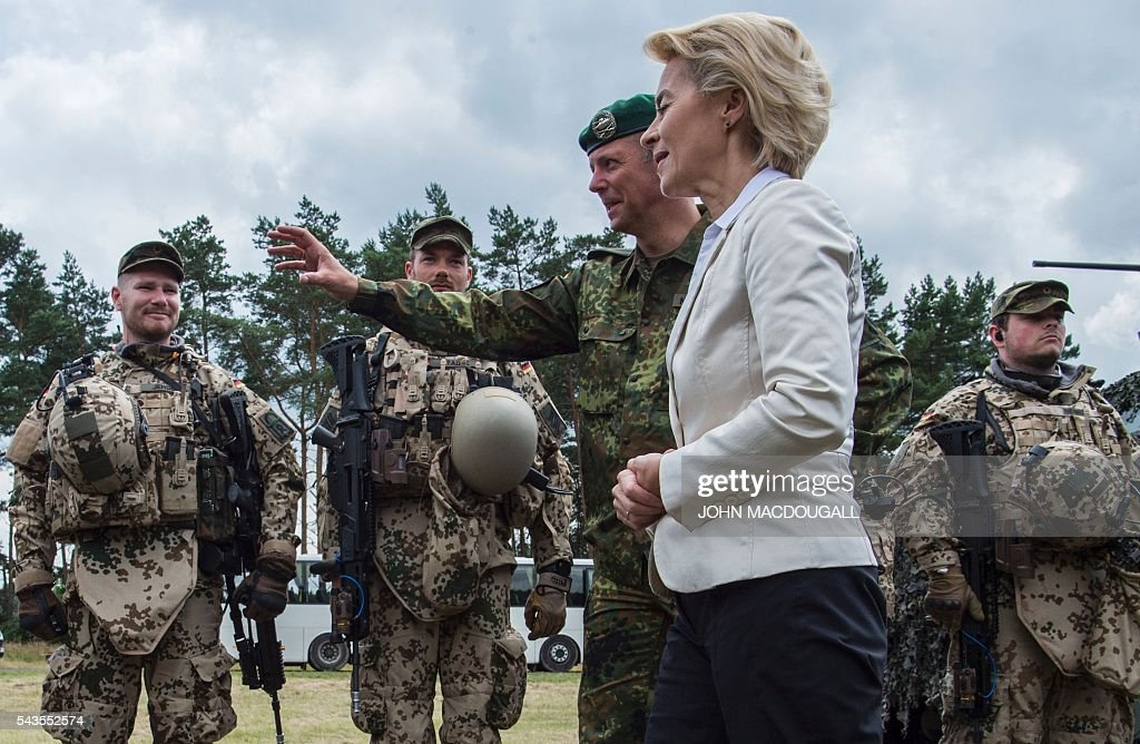 German Defence Minister Ursula von der Leyen congratulates soldiers of the 33rd Panzergrenadier bataillon following a drill which involved the new Puma Armoured Infantry Fighting Vehicle, at their headquarters in Neustadt am Ruebenberge on June 29, 2016. / AFP / JOHN