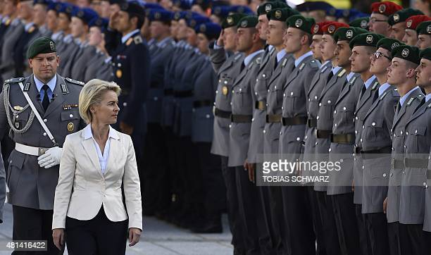 German Defence Minister Ursula von der Leyen inspects the guard of honour during swearingin ceremony of German Bundeswehr soldiers at the...